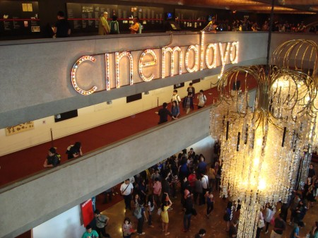 The main lobby of the Cultural Center of the Philippines during Cinemalayà 2013, with chandeliers and the word 'cinemalayà' in colored lights