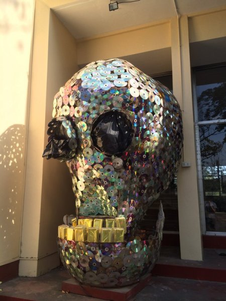 A large skull partly made of recycled CDs on display in front of Albert Hall, UP Diliman, Quezon City