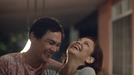 A still of Dagitab (2014) showing actors Nonie Buencamino and Eula Valdez, embracing and laughing