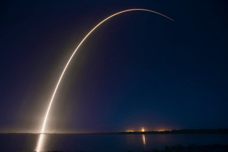 An evening SpaceX Falcon 9 rocket launch