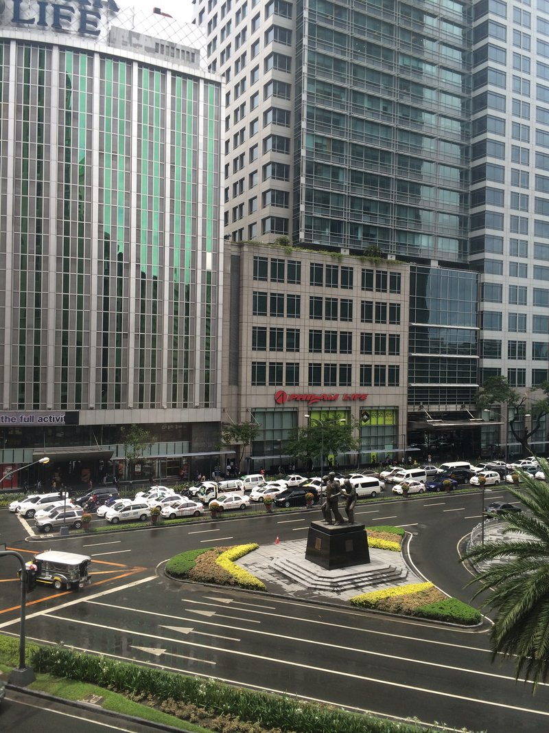 A monument of Ninoy Aquino stands in the corner of Ayala Avenue and Paseo de Roxas in Makati City