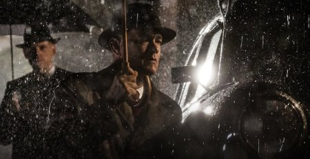 Tom Hanks's character, James Donovan, in the rain on a scene from 2015 film Bridge of Spies.