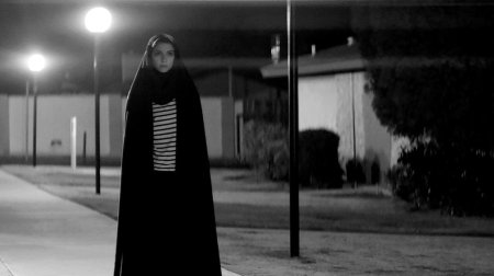 Actress Sheila Vand as a chador-wearing vampire on the streets at night.