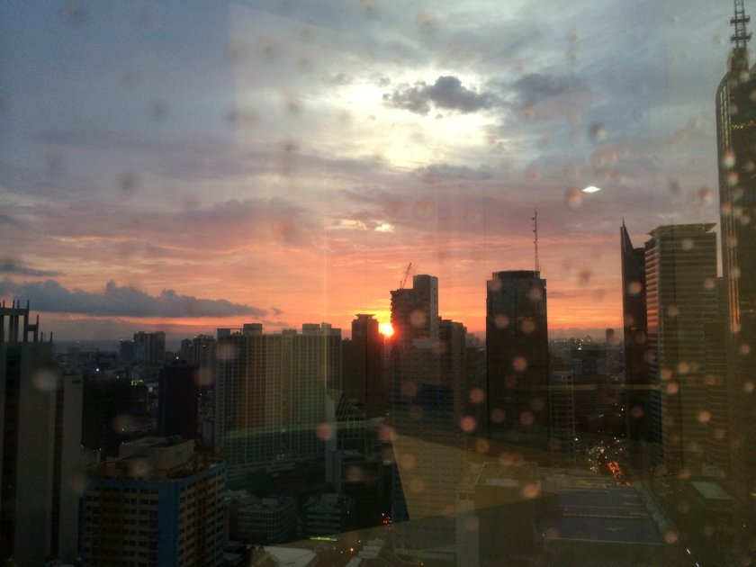 A rainy sunset as viewed from a skyscraper in Makati City.