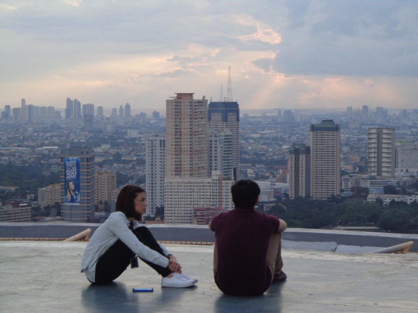 Glaiza de Castro and Dominic Roco as Gem and Barry in the film Sleepless, hanging out on a rooftop.