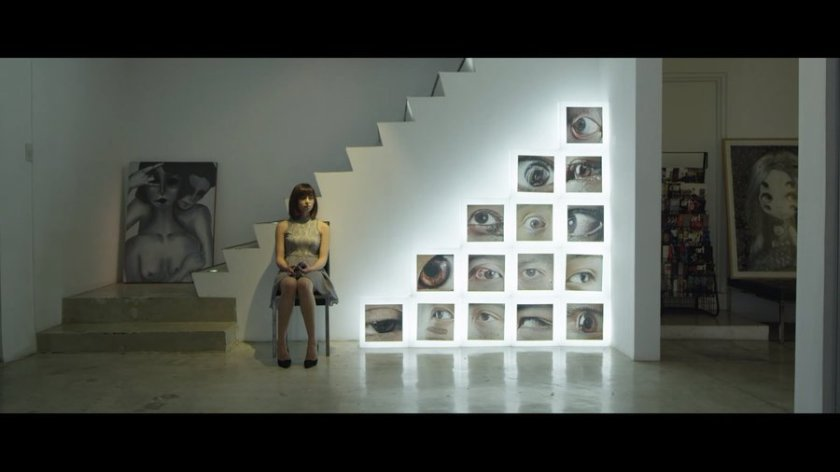 Glaiza de Castro as Gem in Sleepless (2015), sitting in a contemporary art gallery.