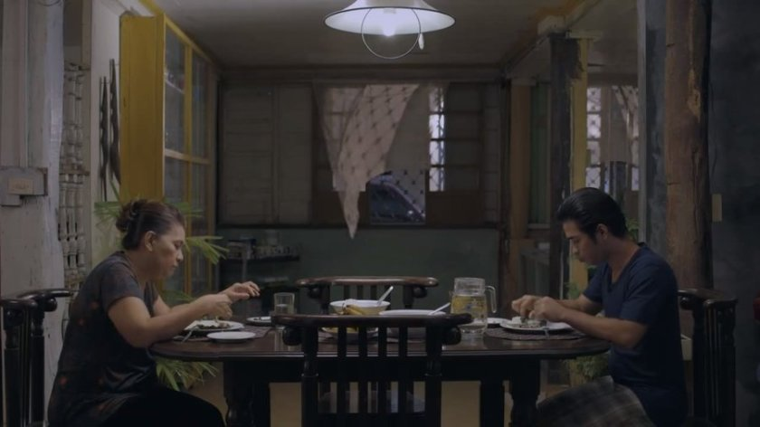 Tessie Tomas and Jun-Jun Quintana as Pina and Filemón in Water Lemon (2015), dining in an old family home