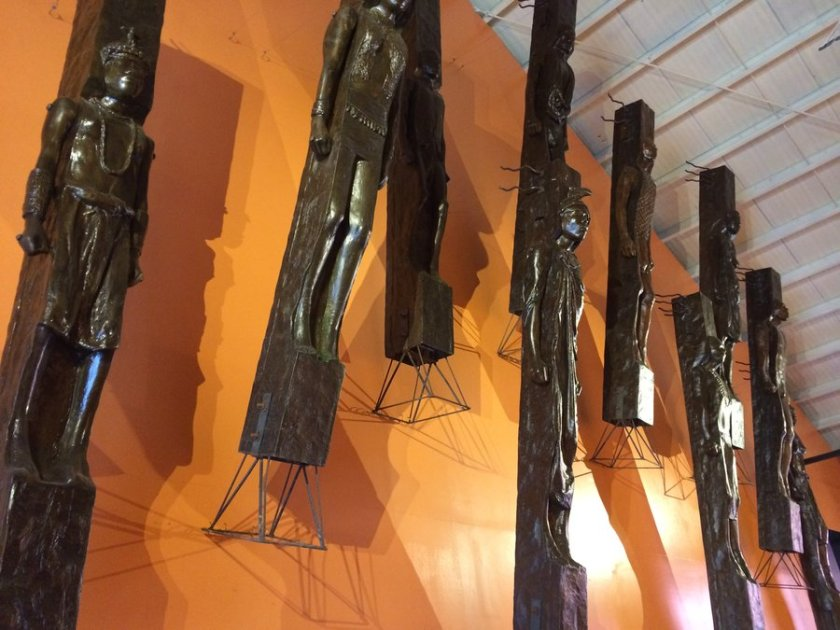 Sculptures by Nato Ong, titled Celestial Warriors, are on display at Taoid Museum; the set of life-sized wooden sculptures portray Cordilleran people carved on massive posts.