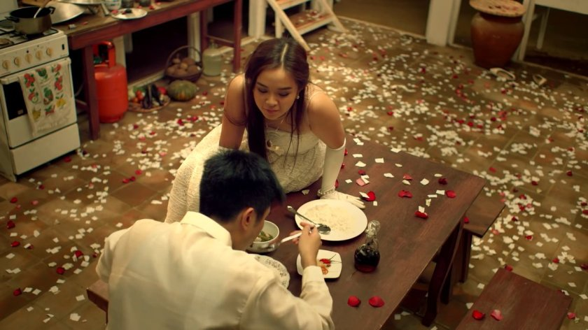 Katrina Legaspi and CJ Navato wearing wedding costumes in the kitchen; screen capture from the Kusina (2016) trailer, youtube.com/watch?v=-oMf5p7D4Tk