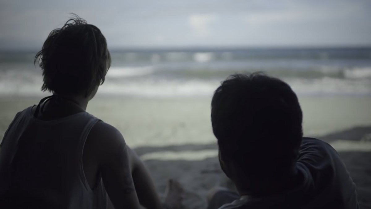 Annicka Dolonius and Sid Lucero watching the beach in Baler, in Apocalypse Child (2015).