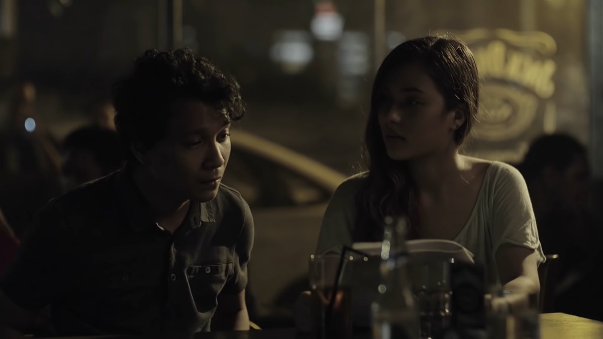 Nicco Manalo and Emmanuelle Vera as Sam and Isa in a bar scene in Ang Kwento Nating Dalawa (2015).
