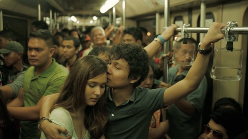 Emmanuelle Vera and Nicco Manalo as Isa and Sam riding an LRT 1 train in Ang Kwento Nating Dalawa (2015).