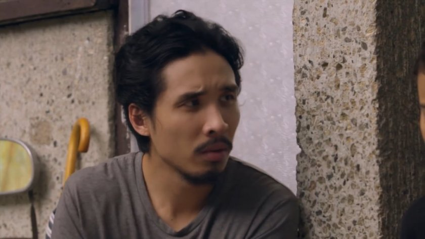Pepe Herrera as Paul, sitting on doorsteps, in 'Sakaling Hindi Makarating'.