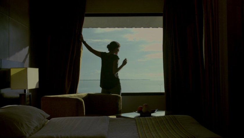 Alessandra de Rossi as Cielo opening a Zamboanga hotel window in 'Sakaling Hindi Makarating'.