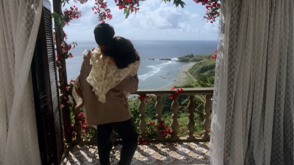 Dawn Zulueta and Richard Gomez as Carmina and Gabriel on a balcony overlooking the coast in 'Hihintayin Kita Sa Langit' (1991).