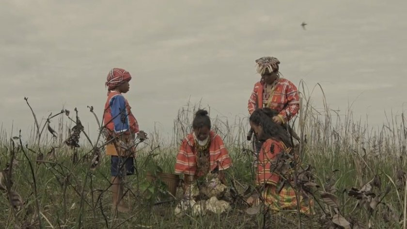 Scene from 'Tu Pug Imatuy': a lumad family burying a dead child on the mountains.