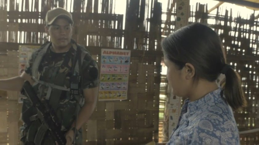 Scene from 'Tu Pug Imatuy': a soldier interrogating a teacher in a remote schoolhouse in Mindanao.