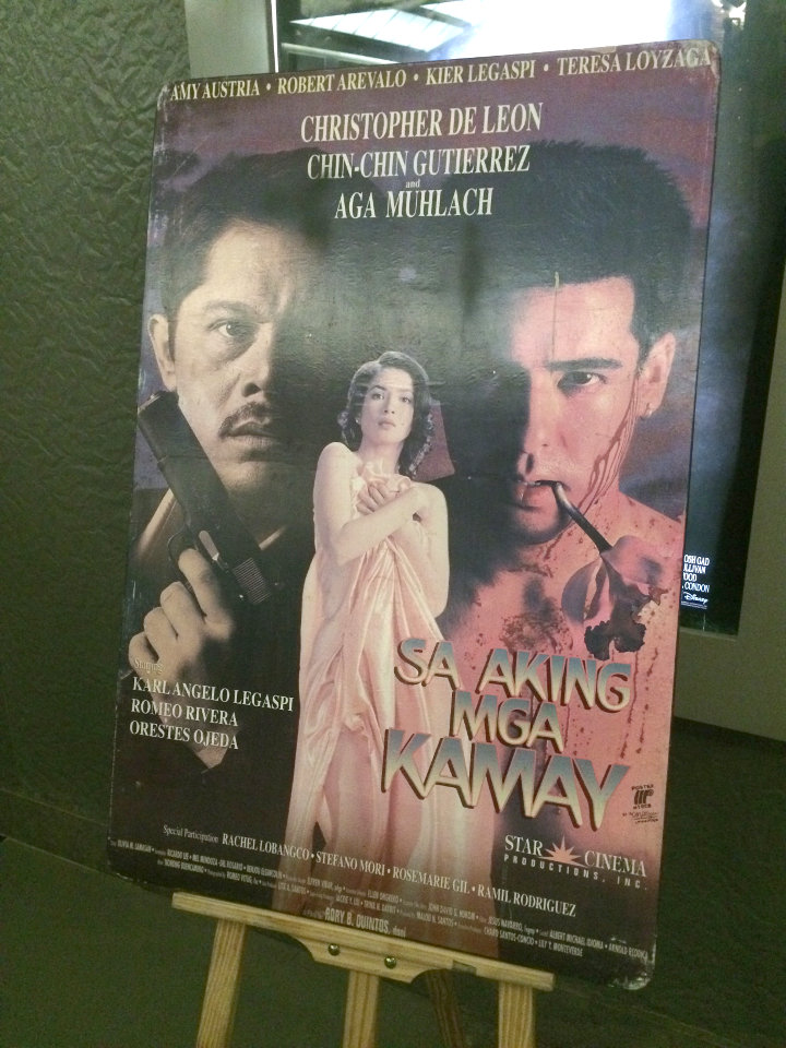 The original, faded poster of 'Sa Aking Mga Kamay' (1996) on display at the restored film's premiere, in Makati City.