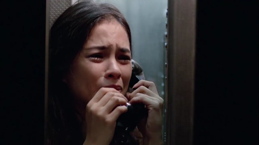 Chin-Chin Gutierrez, as Camille dela Rosa, crying while talking on the telephone in 'Sa Aking Mga Kamay' (1996).