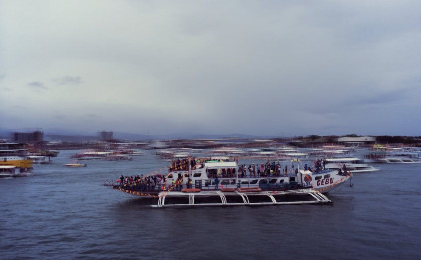 A boat on the Mactan Channel during a fluvial parade in honor of Sto. Niño.