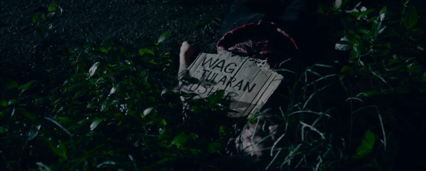 "A body's victim with a ""Pusher ako, 'wag tularan"" sign, in 'Ang Manananggal sa Unit 23B'."