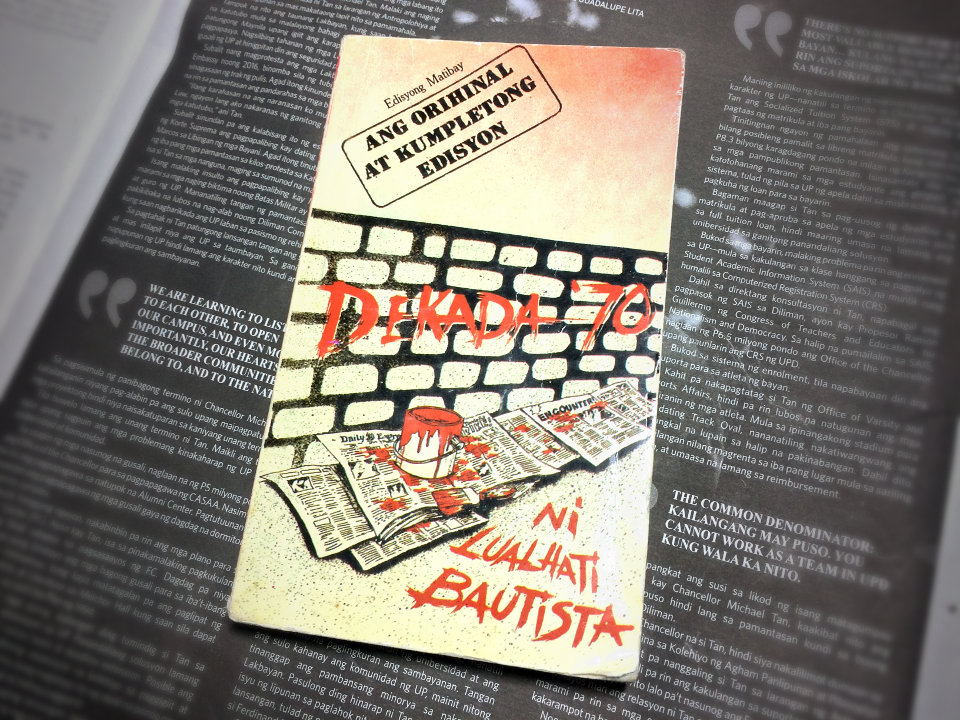 The book cover of Lualhati Bautista's 'Dekada '70', depicting a wall vandalized with red paint.