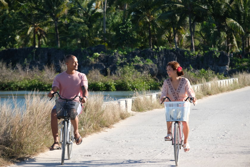 Will Devaughn and Roxanne Barcelo as Viktor and Jennifer biking in Santa Fe, in 'I Found My Heart in Santa Fe'.