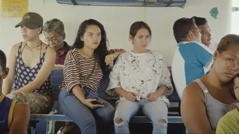 Rya De Guzman and Nicole Blackman sitting in a ferry in 'Babylon'.