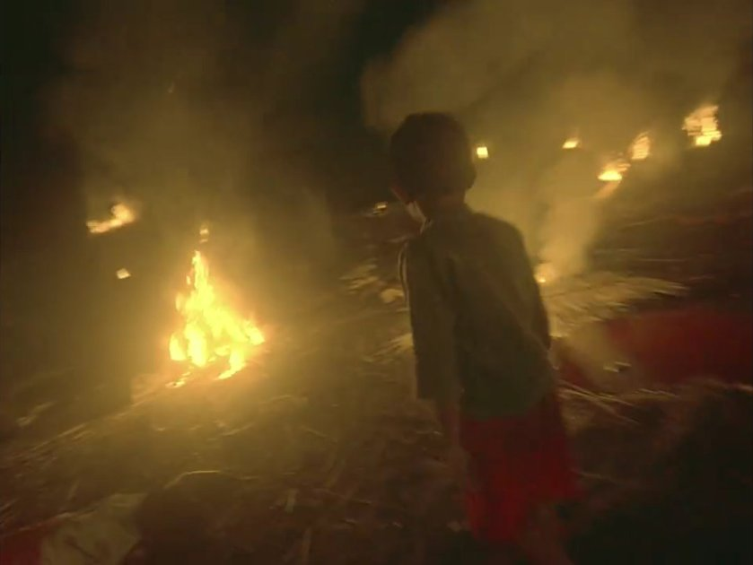 Justine Samson as Kulas walks in the middle of a burning village in 'Balangiga: Howling Wilderness'.