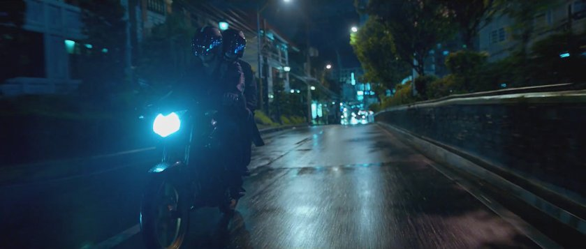 Death squad members riding in tandem on a motorcycle at night, as portrayed in 'Neomanila'.