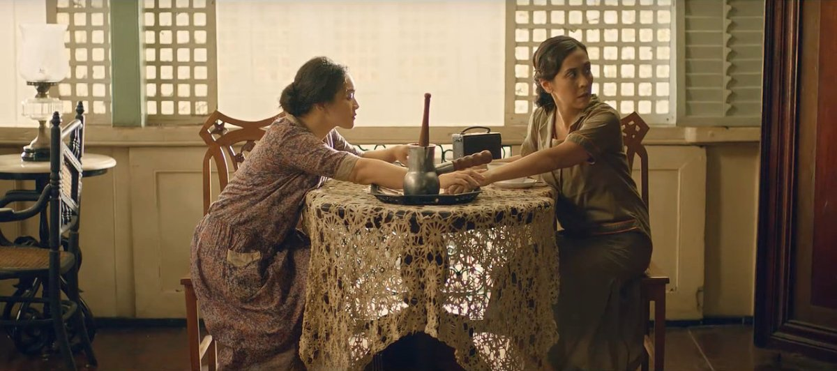 Joanna Ampil and Rachel Alejandro as Candida and Paula, making chocolate in their ancestral, colonial-style house in 'Ang Larawan' (2017).
