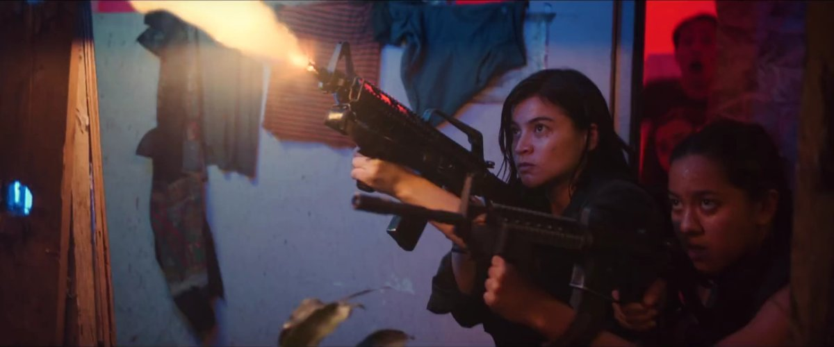Anne Curtis and Mara Lopez fire at their enemies in 'BuyBust' (2018).