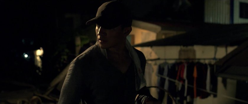 Andres Vasquez as a hired killer stalking his victim at night in 'The Lookout' (2018).