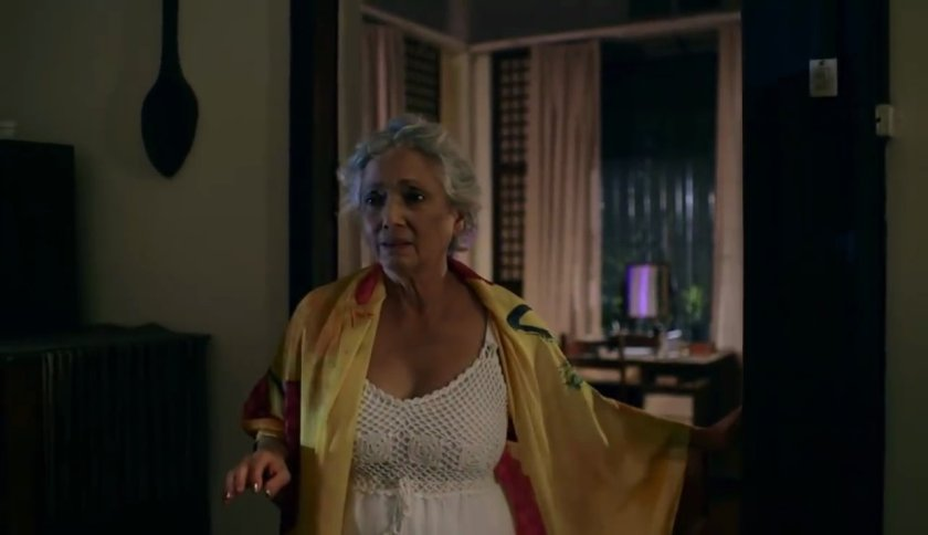 Celeste Legaspi as the titular character coming out of her bedroom in 'Mamang'.