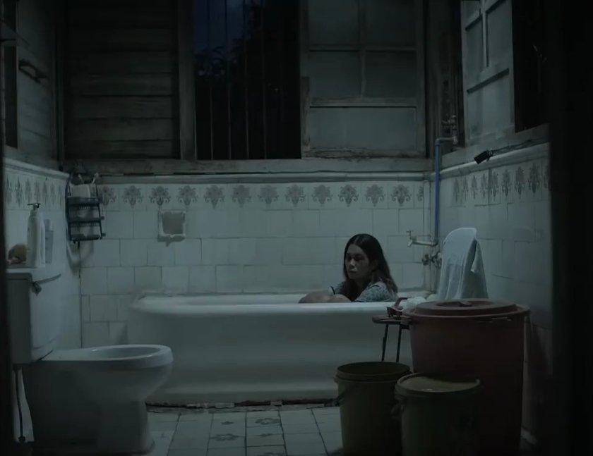 Marietta Subong as Sonya in 'Oda sa Wala', sitting in a white bath tub in a bathroom with white tiles and fixtures.