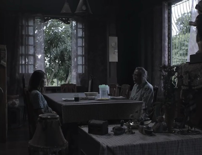 Marietta Subong and Joonee Gamboa as Sonya and her father Rudy in 'Oda sa Wala', sitting across each other around the dining table in an old house, facing each other awkwardly.