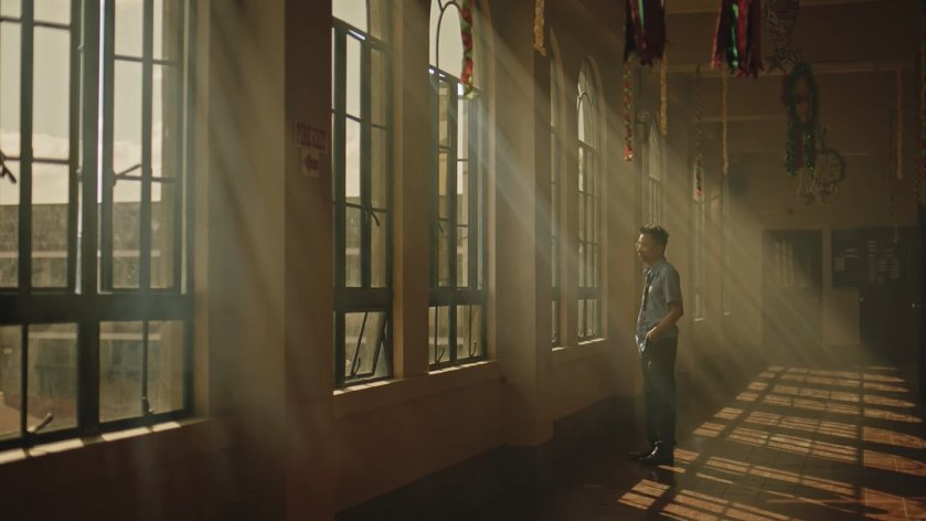 Nicco Manalo as Sam, deep in thought while standing along a school corridor bathed in sunlight, in 'Tayo sa Huling Buwan ng Taon' (2019).