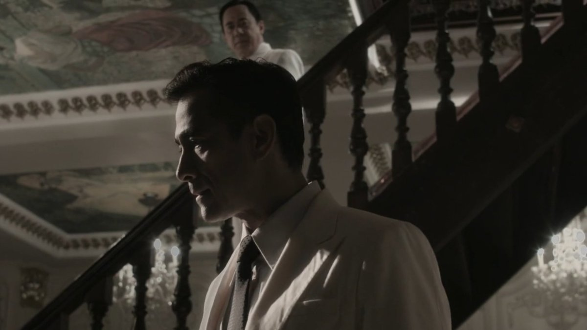 Raymond Bagatsing as Manuel Quezon in a white suit, deep in worried thought, in 'Quezon's Game' (2018).